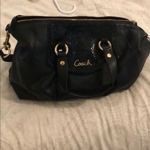 Classic black and gold Coach purse